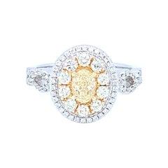 0.45 Carat Oval Yellow Diamond White Diamond Halo Ring Set in 14 Karat Gold