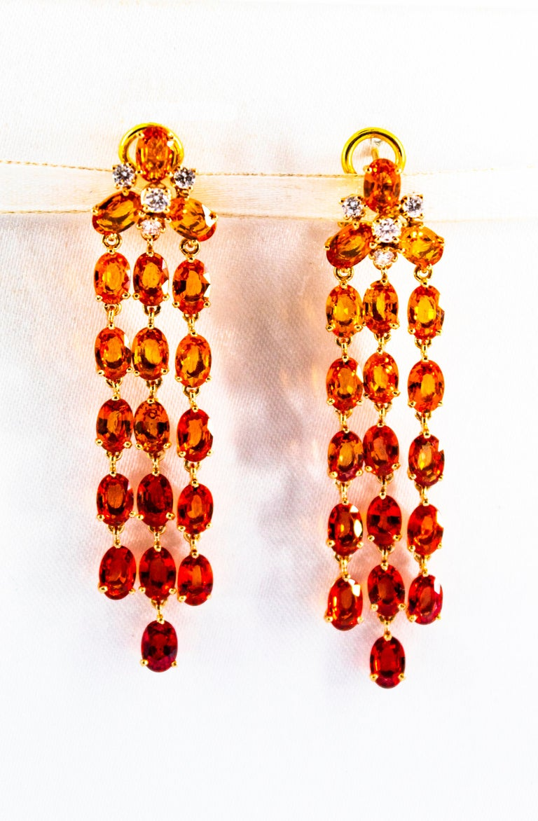 These Earrings are made of 14K Yellow Gold with 18K Yellow Gold Clips. These Earrings have 0.45 Carats of White Diamonds. These Earrings have 21.30 Carats of Yellow Sapphires. These Yellow Sapphires create a waterfall that starts with an intense