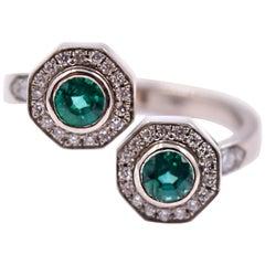 0.46 Carat Emerald and 0.38 Carat White Diamond Bypass Diamond Ring