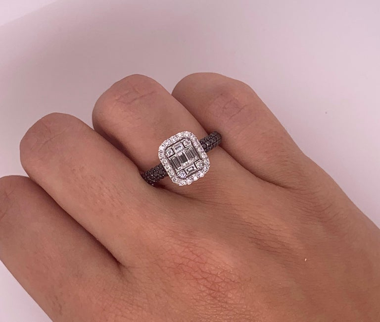Material: 18k White Gold  Stone Details: 50 Round Black Diamond at 0.47 Carats Diamond Details: 24 Round White Diamonds at 0.21 Carats Diamond Details: 5 Baguette Diamonds at 0.31 Carats The face of this ring measures 9.5 x 11 millimeters.  Alberto