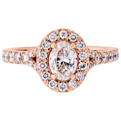 0.47 Carat Oval Diamond F/SI2 GIA Halo Engagement Ring