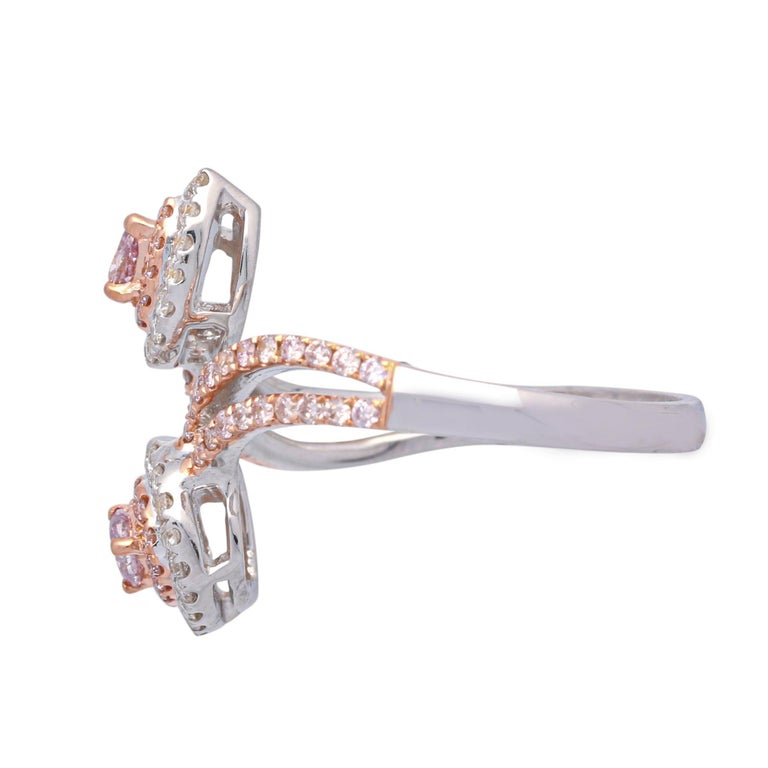 This beautiful Gin and Grace bypass ring is crafted in 18-karat Two Tone gold and features two pear shaped Pink Diamonds 0.16 Carat, surrounded by 62 Pink Diamonds 0.32 Carat & 34 Round Diamonds 0.21 Carat. This ring comes in size 7 and is a perfect