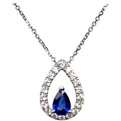 0.49 Carat Pear Shape Sapphire and 0.25 Carat Diamond Halo Cutout Pendant