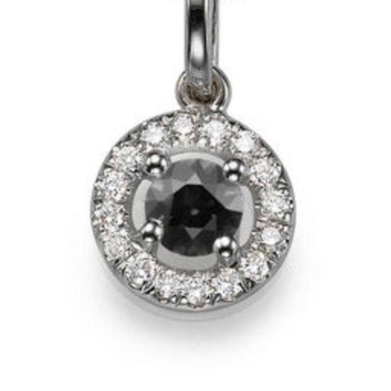 A handmade Black Diamond pendant necklace made of 14K White Gold set with a Round cut Black Diamond of 0.35 carat accented by 15 natural round diamonds. The center stone of this beautiful pendant necklace is of excellent cut, and Black color. The