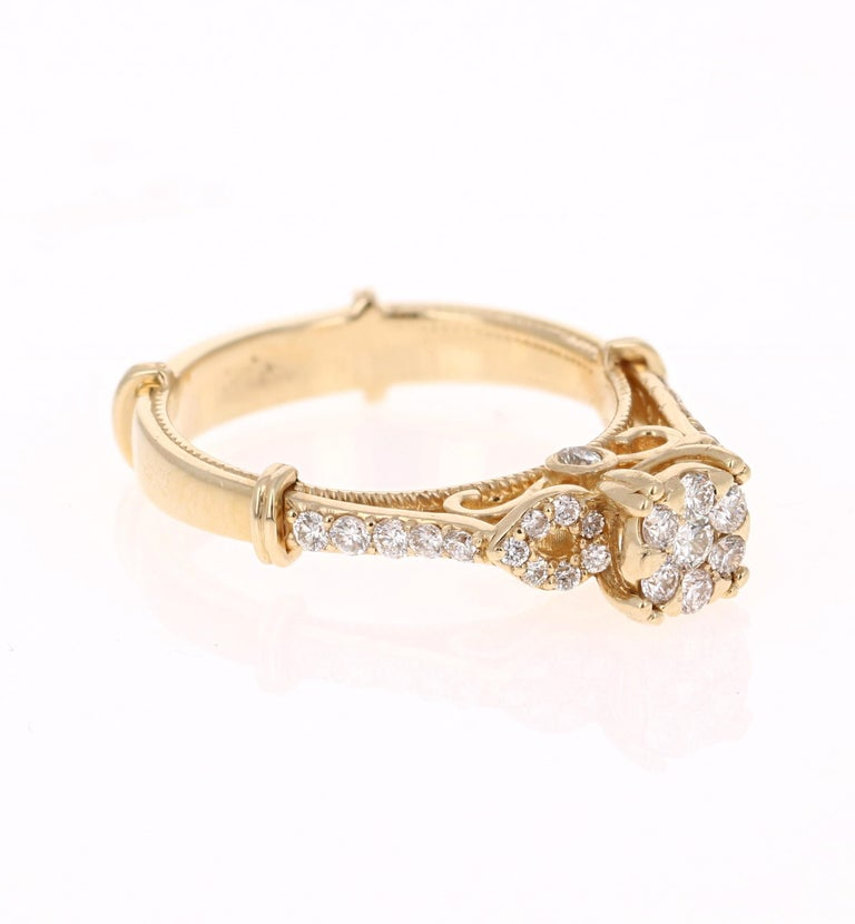 This unique ring has 66 Round Cut Diamonds that weigh 0.50 Carats.   It is beautifully set in 14 Karat Yellow Gold and weighs approximately 4.3 grams  The ring is a size 6 1/2 and can be re-sized free of charge.