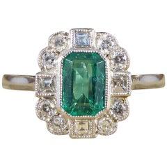 0.50 Carat Emerald and Diamond Cluster Ring in Platinum