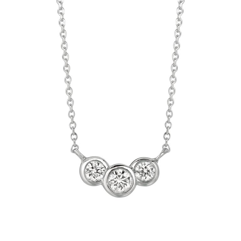 0.50 Carat Natural 3 Stone Diamond Bezel Necklace 14K White Gold G SI      100% Natural Diamonds, Not Enhanced in any way Round Cut Diamond Necklace with 18'' chain       0.50CT     Color G-H      Clarity SI       14K White Gold   Bezel style  2.7