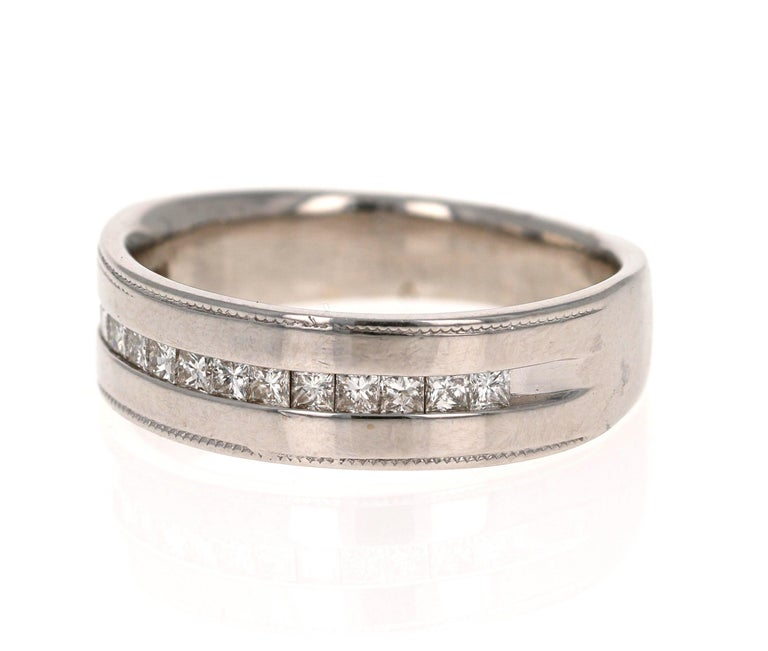 Looking for a Father's Day Gift or an Engagement Band?!  Check out our Men's Collection!  This classic Mens' Ring is set with 13 Princess Cut Diamonds that weigh 0.50 Carats (Clarity: VS, Color: F).  The Total Carat Weight of this ring is 0.50
