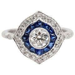 0.50 Carat Round Diamond and Blue Natural Sapphire 18 Carat White Ring