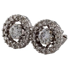 0.50 Carat Round Diamond Halo Stud Earrings Set in 14 Karat White Gold