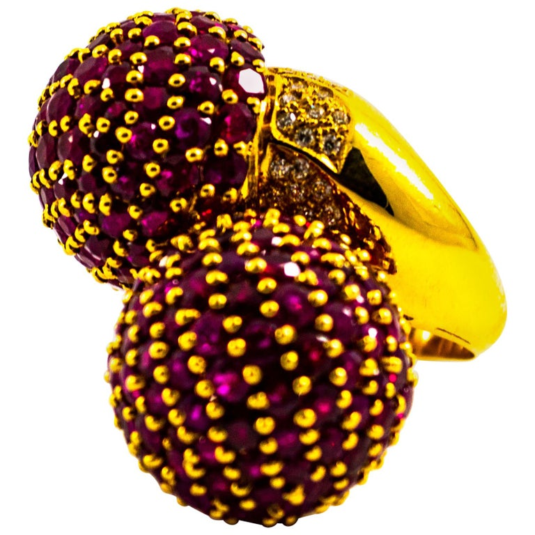 This Contrarié Pavé Ring is made of 18K Yellow Gold. This Ring has 0.50 Carats of White Modern Round Cut Diamonds. This Ring has 19.60 Carats of Rubies. Size ITA: 16 Size USA: 7.5 We're a workshop so every piece is handmade, customizable and