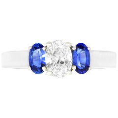 0.50 Carat White Diamond and 0.61 Carat Blue Sapphire 3-Stone Engagement Ring