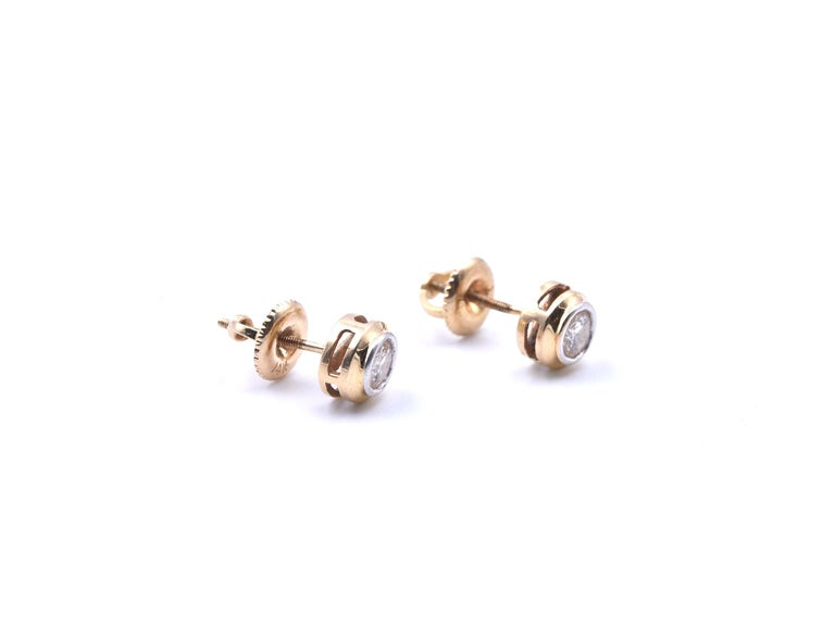 Designer: custom design Material: 14k yellow gold Diamonds: two round brilliant cut = 0.50 carat weight Color: J Clarity: SI2-I1 Dimensions: each earring is 6.5mm diameter Fastenings: screw-backs Weight: 1.23 grams