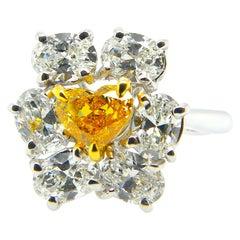 0.51 Carat GIA Certified Fancy Vivid Orange-Yellow Diamond and Diamond Ring
