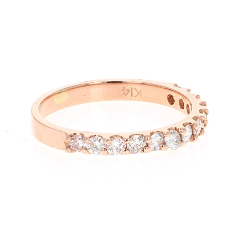 This band has 13 Round Cut Diamonds that weigh 0.51 Carats. The clarity and color of the diamonds are VS-H.  Crafted in 14 Karat Rose Gold and is approximately 1.7 grams   The ring is a size 6 and can be re-sized at no additional charge!