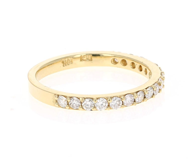 A beautiful band that can be worn as a single band or stack with other bands in other colors of Gold!   This ring has 17 Round Cut Diamonds that weigh 0.51 Carats. The clarity and color of the diamonds are VS-H.  Crafted in 18 Karat Yellow Gold and