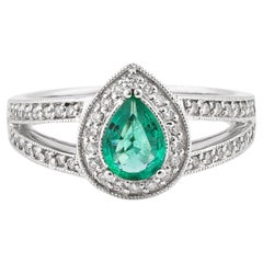 0.53 Carat Emerald and White Diamond Ring in 14 Karat White Gold