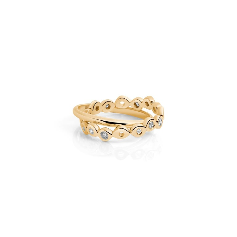 These two rolling ring bands are comfortable, make a statement and work great as alternative wedding bands. Hi June Parker's best selling Shadows ring band has been upgraded with a few more diamonds and connected to a plain half-round ring band for