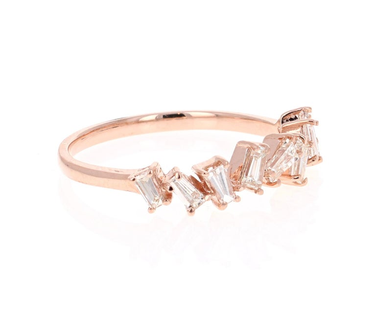 Unique and cute band that can be worn as a single band or stack with other bands in other colors of Gold!   This ring has 12 Baguette Cut Diamonds that weigh 0.55 Carats.   Crafted in 14 Karat Rose Gold is 2.0 grams   The ring is a size 7 and can be