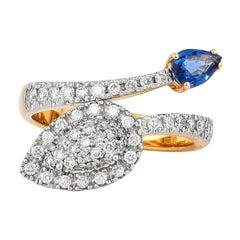 0.55 Carat Blue Sapphire and Diamond Ring in 18 Karat Yellow Gold