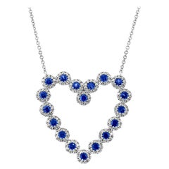 0.55 Carat Diamond and 0.79 Carat Blue Sapphire 14 Karat Gold Heart Necklace