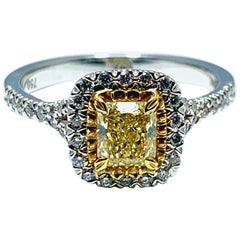 0.55 Carat Fancy Yellow Cushion Shaped Diamond and Platinum Engagement Ring