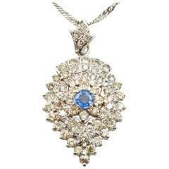 0.55 Carat Tanzanite and Diamond 14 Karat White Gold Necklace