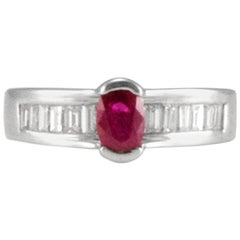 0.56 Carat Oval Ruby and Baguette Diamond White Gold Cocktail Ring