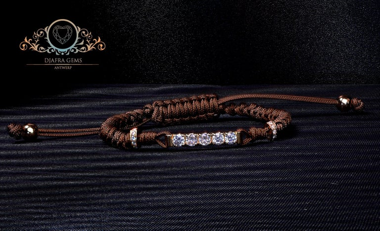 Contemporary macramé bracelet, featuring a 0.56 total carat worth round cut Moissanites set in 18 karat rosé gold. The center piece is set with 5 x 0.10 carat white round moissanites and on the sides there are additional 18 karat rosé golden rings