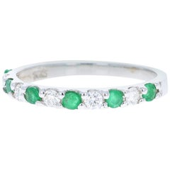 0.58 Carat Emerald and Diamond 14 Karat White Gold Band