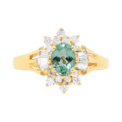 0.58 Carat Oval Shaped Paraiba Tourmaline and White Diamond Ring