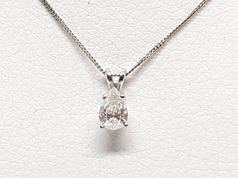 Gold: 18K White Gold.  Weight: 2.16 gr.  Diamond: 0.58ct. Colour: F Clarity: SI1  Length Pendant: 1.00 cm.  Width Pendant: 4.78 cm.  Length chain: choose between 40, 42, 45 or 50cm.  All our jewellery comes with a certificate and a 5 year guarantee