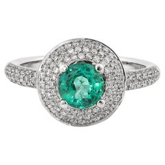 0.6 Carat Emerald and White Diamond Ring in 14 Karat White Gold