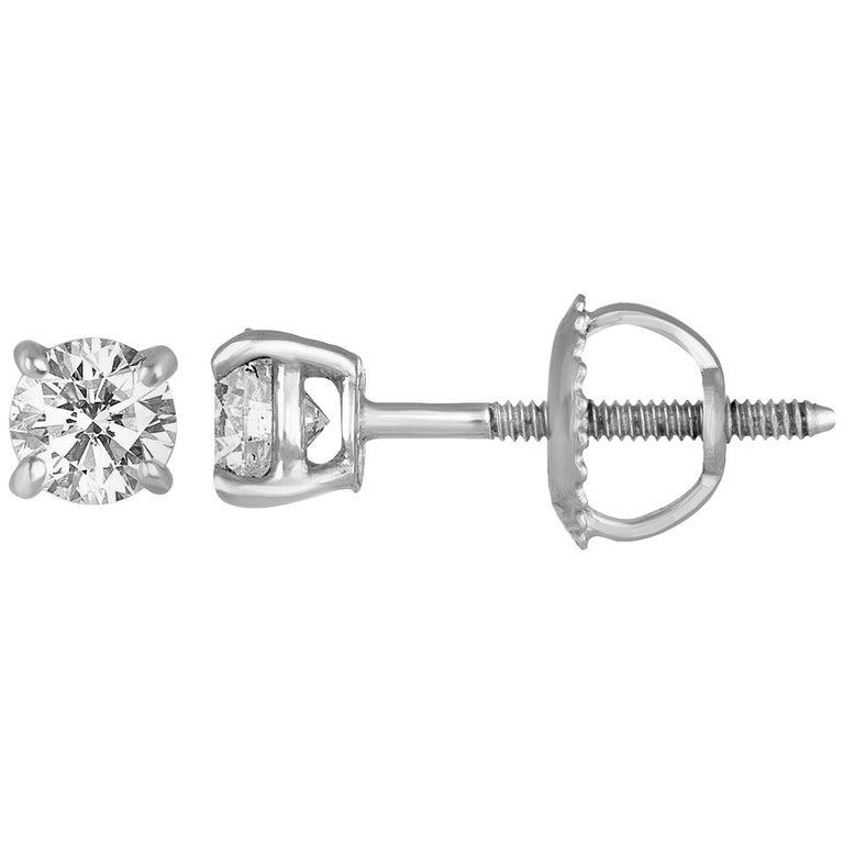 0.60 Carat Diamond Gold Stud Earrings For Sale