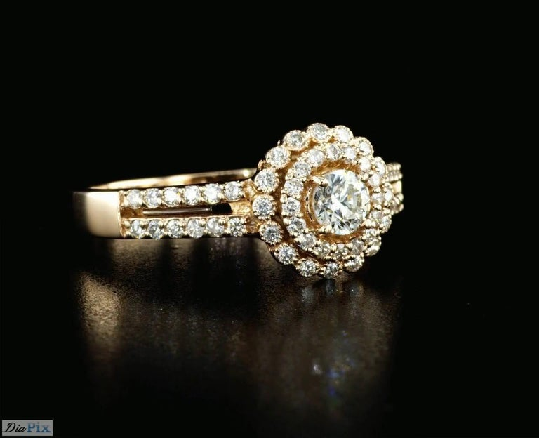 Art Deco 0.60 Carat Diamond Halo Engagement Ring with Rose Gold For Sale