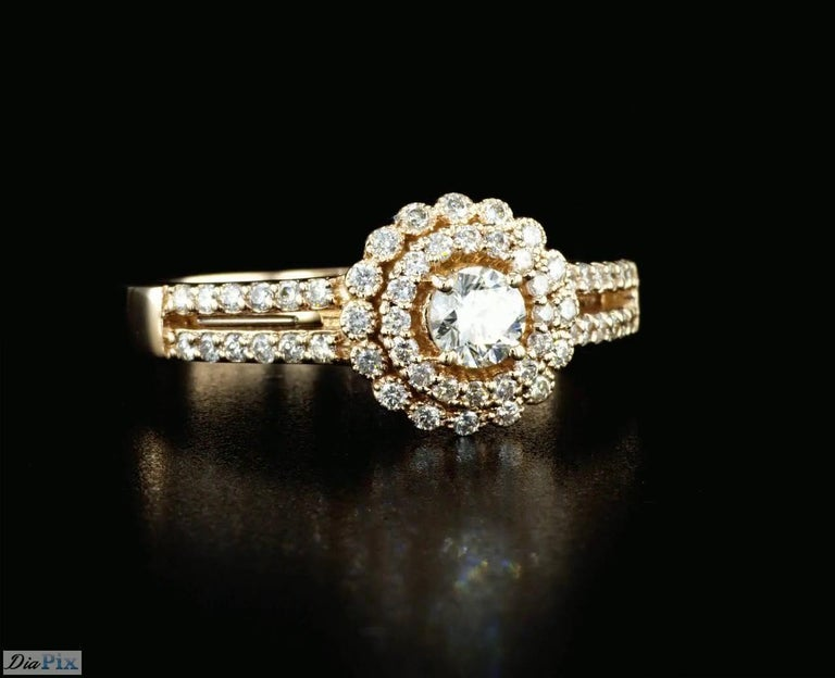 Round Cut 0.60 Carat Diamond Halo Engagement Ring with Rose Gold For Sale