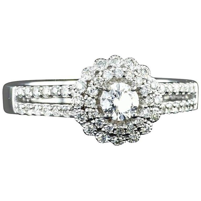 0.60 Carat Diamond Halo Engagement Ring 14K White Gold For Sale