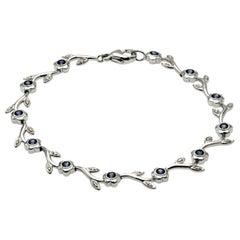 0.60 Carat Natural Blue Sapphire & 0.12 Carat Diamonds 14K Gold Flower Bracelet