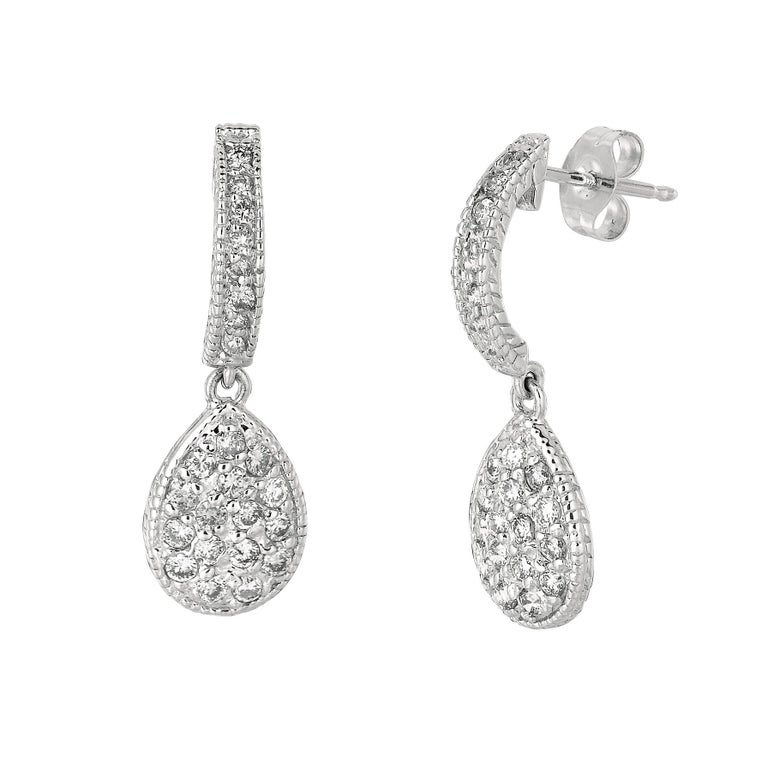 0.60 Carat Natural Diamond Earrings G SI 14K Yellow Gold      100% Natural, Not Enhanced in any way Round Cut Diamond Earrings     0.60CT     Color G-H      Clarity SI       14K White Gold  1.90 grams, Pave style      7/8 inch in height, 5/8 inch
