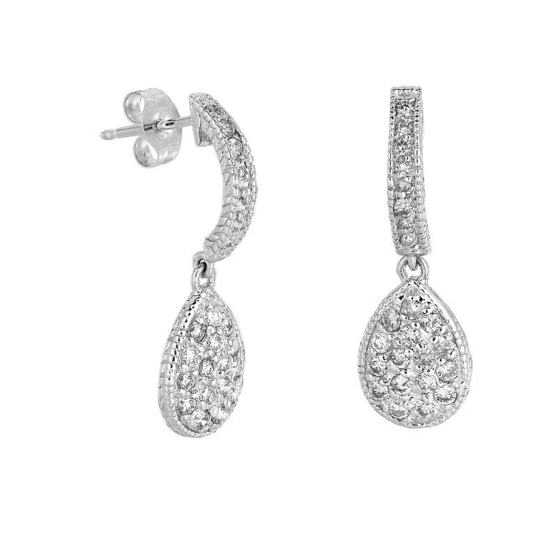 Contemporary 0.60 Carat Natural Diamond Pear Shape Drop Earrings G SI 14 Karat Yellow Gold For Sale