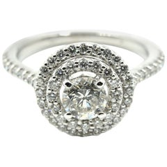 0.60 Carat Round Brilliant Diamond Halo Engagement Ring 14 karat White Gold