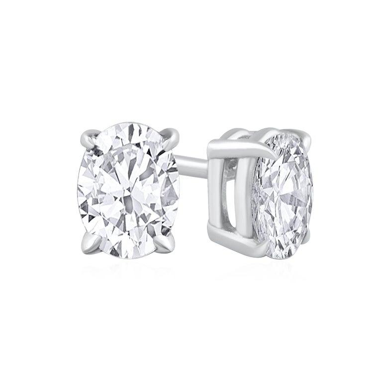 0.60 Carat Total Oval Cut Diamond Stud Earrings