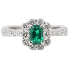 0.61 Carat Colombian Emerald and Diamond Engagement Ring Set in Platinum