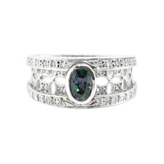 0.61 Carat, Natural Color-Changing Alexandrite and Diamond Ring Set in Platinum