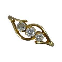 0.61ct Natural Diamond 18 Carat Gold Trilogy Ring on Twist