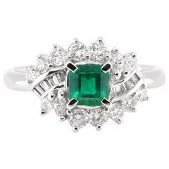 0.62 Carat, Natural Emerald and Diamond Ring Set in Platinum