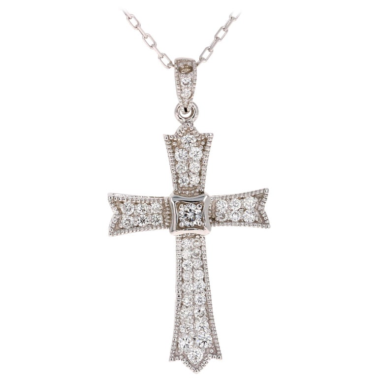 0.64 Carat Diamond Cross Pendant with Chain in 14 Karat White Gold For Sale