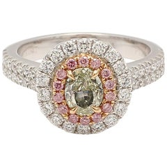 0.64 Carat Green Oval Diamond Ring with Pink and White Diamond Halo