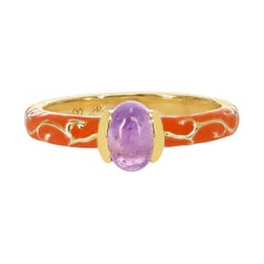0.64 Ct. Oval Amethyst Cabochon with Orange Enamel with Gold Design, 14k