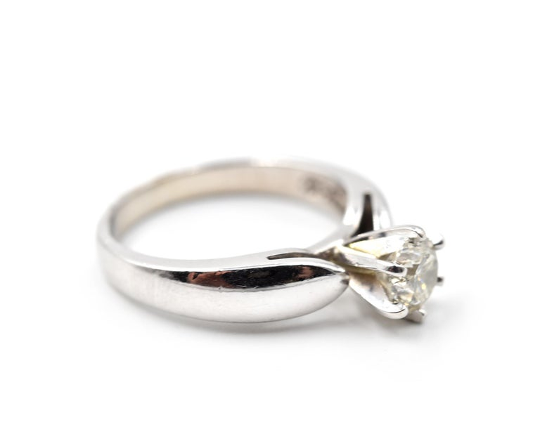 Designer: custom design Material: 14k white gold Diamond: round brilliant cut 0.65 carat Color: H Clarity: SI2 Ring Size: 7 (please allow two additional shipping days for sizing re Weight: 5.20 grams